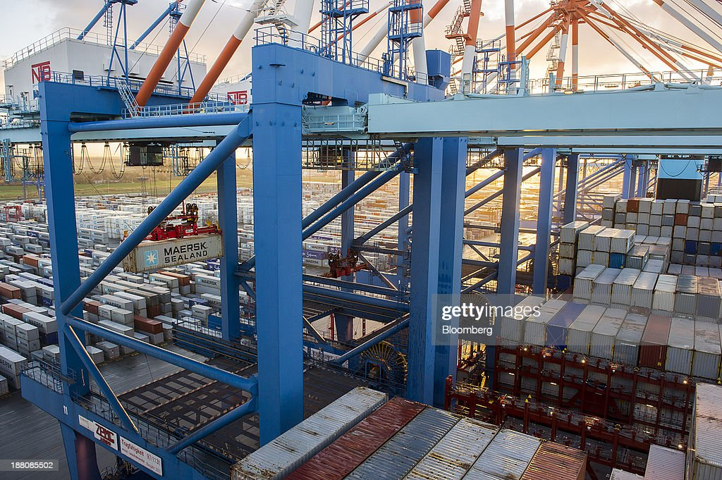 A Maersk branded shipping container is collected by gantry crane during the loading of the Maersk Mc-Kinney Moeller Triple-E Class container ship, operated by A.P. Moeller-Maersk A/S, at the Port of Bremerhaven in Bremerhaven, Germany, on Monday, Nov. 11, 2013. A.P. Moeller-Maersk A/S's container-shipping line, the world's largest, reported an 11 percent increase in third-quarter profit after cost cuts countered a decline in freight rates. Photographer: Kristian Helgesen/Bloomberg via Getty Images
