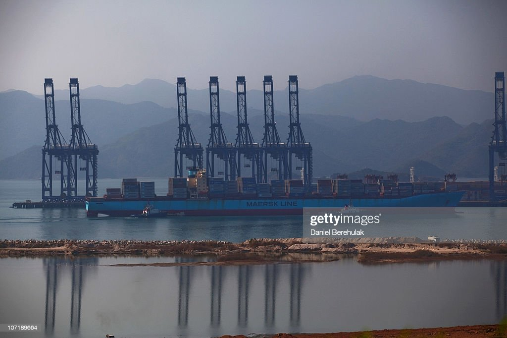 A Maersk Line cargo ship navigates its way into Shenzhen Port on November 28, 2010 in Shenzhen, China. According to the US Commercial Service, Shenzhen is one of the fastest growing cities in the world. Home of the Shenzhen Stock Exchange and the headquarters of numerous technology companies, the now bustling former fishing village is considered southern China's major financial centre.