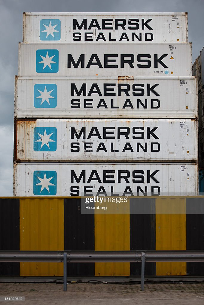 Maersk Sealand shipping containers sit on the dockside at the APM terminal, operated by AP Moeller-Maersk A/S, in the Port of Rotterdam, in Rotterdam, Netherlands, on Thursday, Sept. 19, 2013. The pace of economic contraction in the Netherlands, which is in its third recession in five years, is slowing. Photographer: Jasper Juinen/Bloomberg via Getty Images