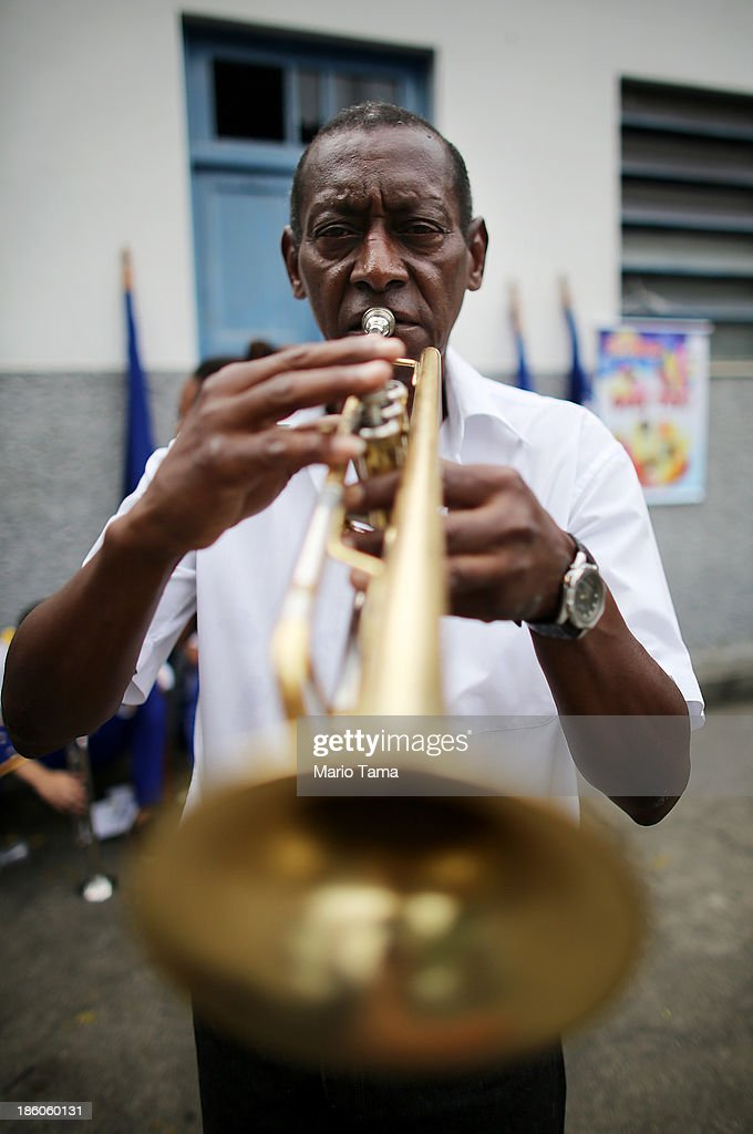Maestro Couto poses before playing in a procession near the Nossa Senhora da Penha Church on the final day of the annual October feast of the patron saint marking the 378th anniversary of the church on October 27, 2013 in Rio de Janeiro, Brazil. Pilgrims often climb the entire 382 steps that lead to the church, originally constructed in 1635, which is perched on a rocky hill. Brazil holds more Catholics than any other country.