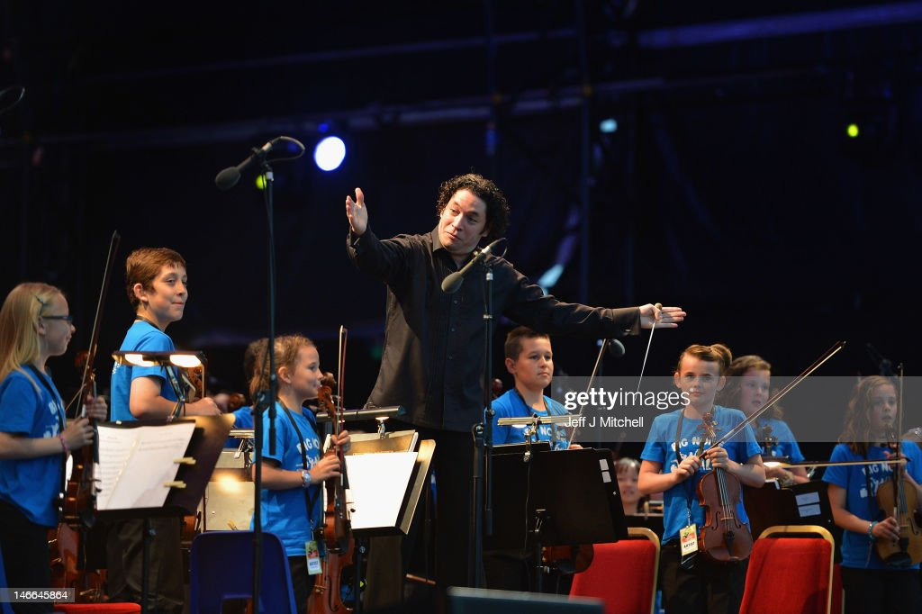 Maestro Gustavo Dudamel conducts the children from the Big Noise Orchestra during the Big Concert on June 21, 2012 in Stirling, Scotland. The Big Concert is the opening event of the London 2012 festival. The special outdoor event set against the backdrop of Stirling Castle, features a full performance by lead by conductor Gustavo Dudamel and the Simon Bolivar Orchestra of Venezuela.