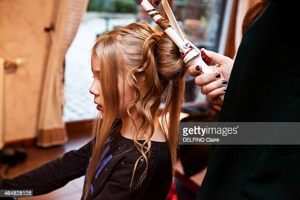 ORLEANS FRANCE NOVEMBER 09 Maeva Metzer 7 years has her hair done during the Mini Miss contest on November 09 2013 near OrleansFrance