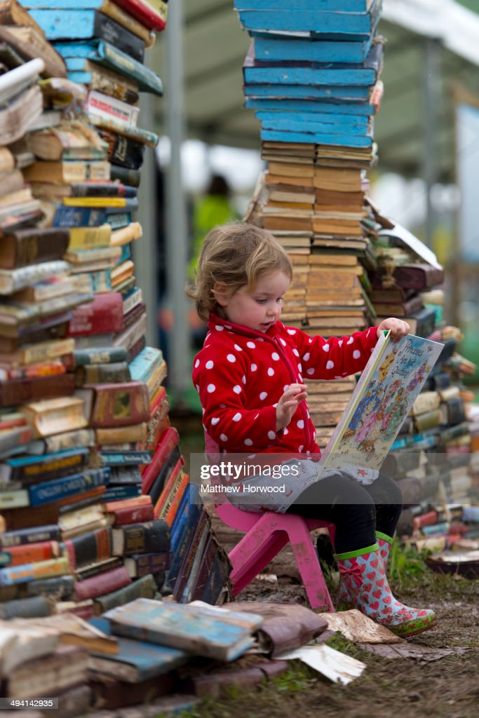Maeve Magee, 3, reads a book during the Hay Festival on May 28, 2014 in Hay-on-Wye, Wales. The Hay Festival is an annual festival of literature and arts which began in 1988.