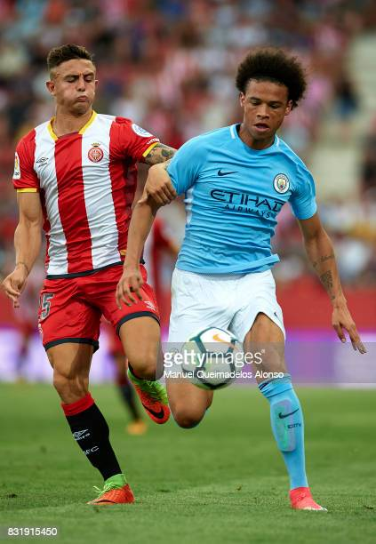 Maffeo of Girona is challenged by Leroy Sane of Manchester City during the preseason friendly match between Girona and Manchester City at Municipal...