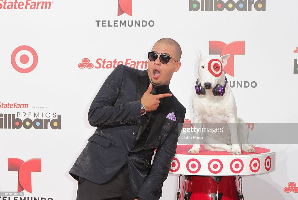 Maffio celebrates with Bullseye, Target's Beloved Bull Terrier Mascot, at the 2013 Billboard Latin Music Awards at BankUnited Center on April 25, 2013 in Miami, Florida.