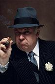 Mafia boss with cigar