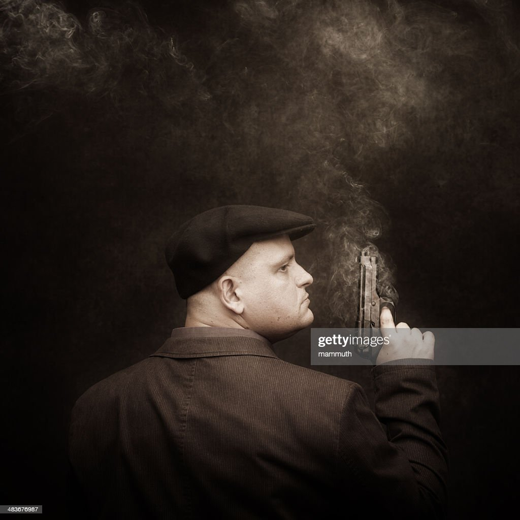 mafia guy with smoking colt : Stock Photo