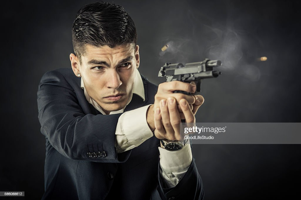 Mafia man shooting a gun