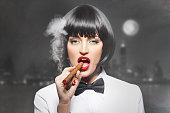 Mafiosi woman boss smoke with cigar in town