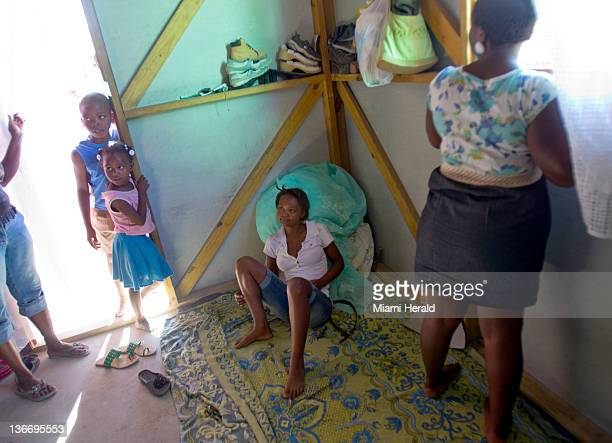Magarette Bonnet center sits in the tiny home of her cousin Jeannine Jean right in Corail January 4 2012 Two years after Haiti's most horrifying 35...