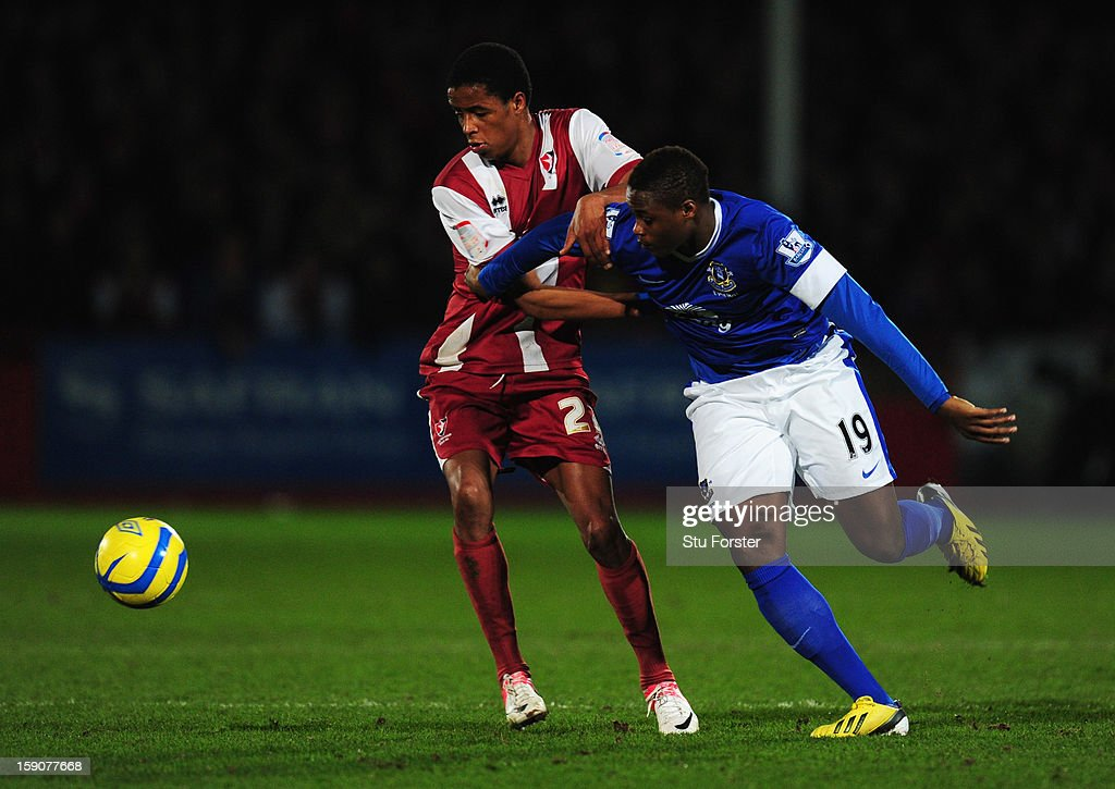 <a gi-track='captionPersonalityLinkClicked' href=/galleries/search?phrase=Magaye+Gueye&family=editorial&specificpeople=7018117 ng-click='$event.stopPropagation()'>Magaye Gueye</a> of Everton battles with Sido Jombati of Cheltenham Town during the FA Cup with Budweiser Third Round match between Cheltenham Town and Everton at Abbey Business Stadium on January 7, 2013 in Cheltenham, England.