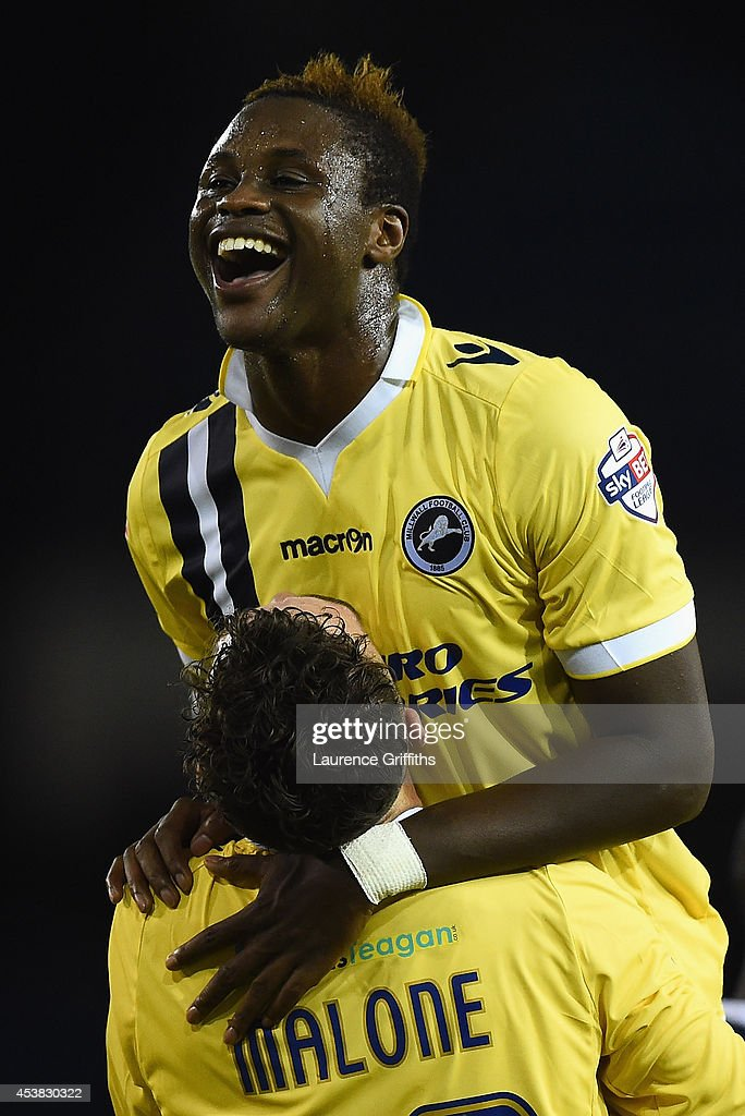 <a gi-track='captionPersonalityLinkClicked' href=/galleries/search?phrase=Magaye+Gueye&family=editorial&specificpeople=7018117 ng-click='$event.stopPropagation()'>Magaye Gueye</a> of Millwall celebrates his last minute equalising goal with Scott Malone during the Sky Bet Championship match between Sheffield Wednesday and Millwall at Hillsborough Stadium on August 19, 2014 in Sheffield, England.