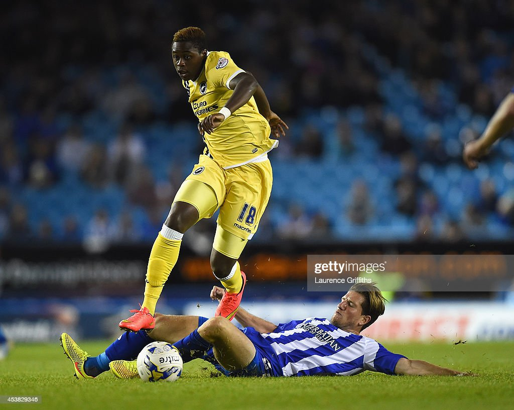 <a gi-track='captionPersonalityLinkClicked' href=/galleries/search?phrase=Magaye+Gueye&family=editorial&specificpeople=7018117 ng-click='$event.stopPropagation()'>Magaye Gueye</a> of Millwall jumps the challenge of <a gi-track='captionPersonalityLinkClicked' href=/galleries/search?phrase=Sam+Hutchinson&family=editorial&specificpeople=4285557 ng-click='$event.stopPropagation()'>Sam Hutchinson</a> of Sheffield Wednesday during the Sky Bet Championship match between Sheffield Wednesday and Millwall at Hillsborough Stadium on August 19, 2014 in Sheffield, England.