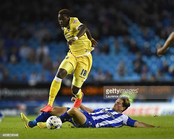 Magaye Gueye of Millwall jumps the challenge of Sam Hutchinson of Sheffield Wednesday during the Sky Bet Championship match between Sheffield...