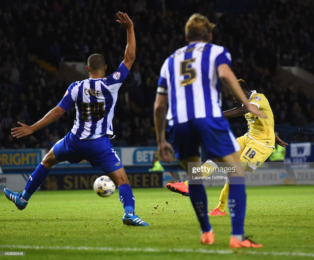 <a gi-track='captionPersonalityLinkClicked' href=/galleries/search?phrase=Magaye+Gueye&family=editorial&specificpeople=7018117 ng-click='$event.stopPropagation()'>Magaye Gueye</a> of Millwall scores a last minute equalising goal during the Sky Bet Championship match between Sheffield Wednesday and Millwall at Hillsborough Stadium on August 19, 2014 in Sheffield, England.