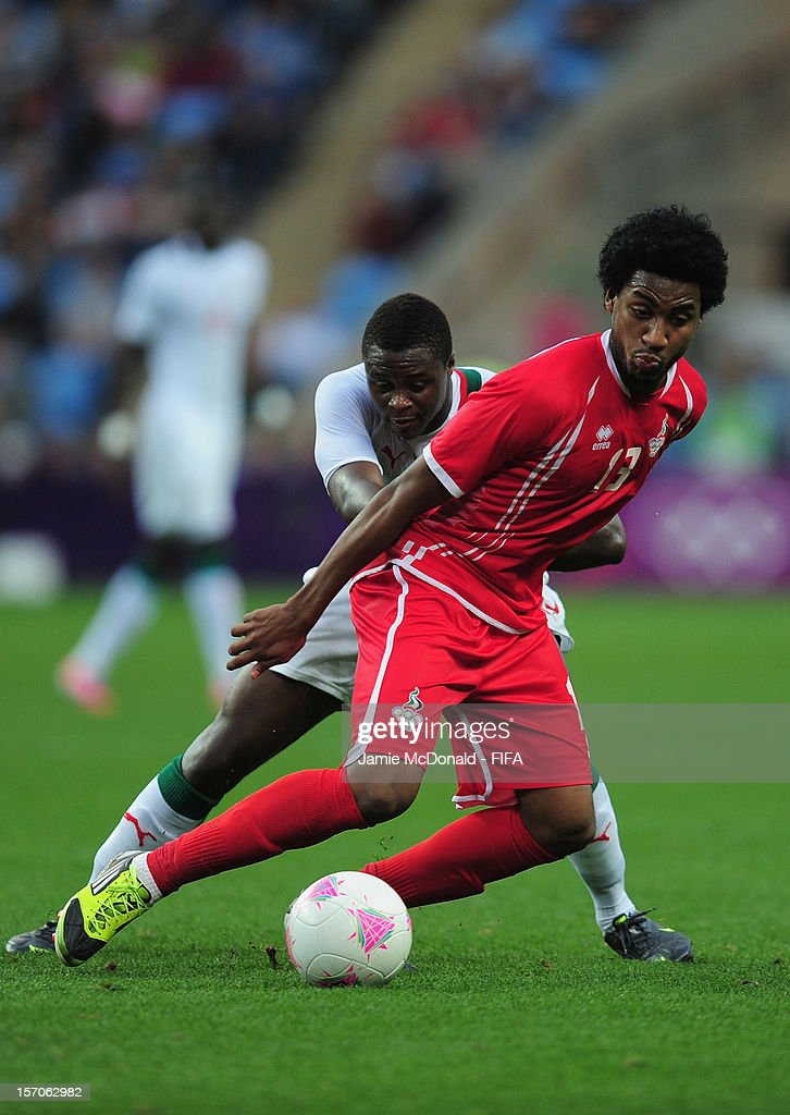 <a gi-track='captionPersonalityLinkClicked' href=/galleries/search?phrase=Magaye+Gueye&family=editorial&specificpeople=7018117 ng-click='$event.stopPropagation()'>Magaye Gueye</a> of Senegal battles with Esmaeel Khamis of United Arab Emirates during the Men's Football first round Group A Match between Senegal and United Arab Emirates, on Day 5 of the London 2012 Olympic Games at City of Coventry Stadium on August 1, 2012 in Coventry, England.