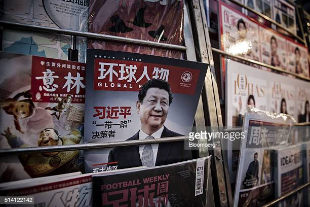 A magazine cover featuring Xi Jinping China's president sits on display at a news stand in Beijing China on Sunday March 6 2016 China's premier Li...