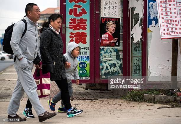 A magazine cover with US presidential candidate Hillary Clinton is displayed at a newsstand in Shanghai on November 8 2016 No matter who triumphs on...