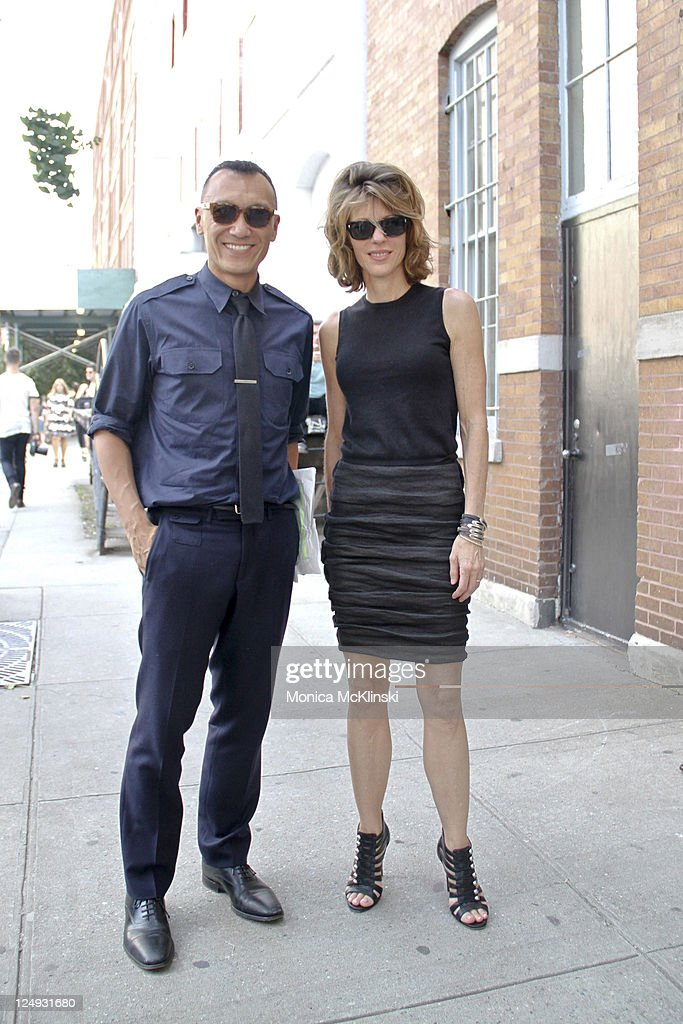 Magazine Creative Director, <a gi-track='captionPersonalityLinkClicked' href=/galleries/search?phrase=Joe+Zee&family=editorial&specificpeople=2257766 ng-click='$event.stopPropagation()'>Joe Zee</a> wearing a Ralph Lauren shirt, Prada necktie, Gucci pants, Churches shoes and Warby Parker sunglasses and ELLE Magazine Editor-in-Chief, Robbie Myers wearing a Prada top, Lanvin skirt, Christian Louboutin shoes and Oliver Peoples sunglasses arrive for the Theyskens' Theory Showing at Center 548 in Manhattan during Spring 2012 Fashion Week on September 13, 2011 in New York City.