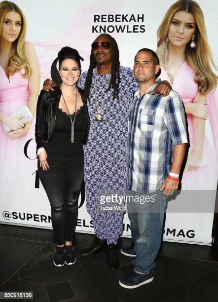 SU Magazine editor in chief Kim Clark rapper Snoop Dogg and Jay Clark at SU Magazine's 17th Anniversary Celebration on August 12 2017 in Hollywood...