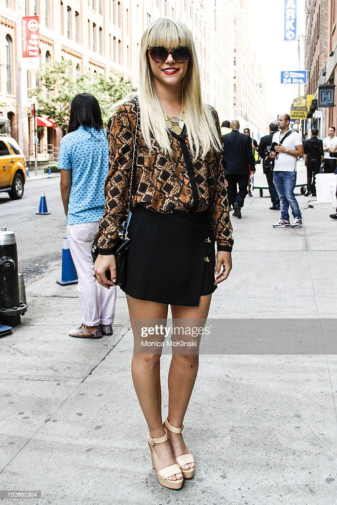 Magazine Editor <a gi-track='captionPersonalityLinkClicked' href=/galleries/search?phrase=Lauren+Scruggs&family=editorial&specificpeople=9123892 ng-click='$event.stopPropagation()'>Lauren Scruggs</a> seen wearing a Zara ensemble of top, skirt and shoes, Urban Outfitters bag and Ray Ban sunglasses outside the Costello Tagliapietra showing at Milk Studios at Streets of Manhattan on September 6, 2012 in New York City.