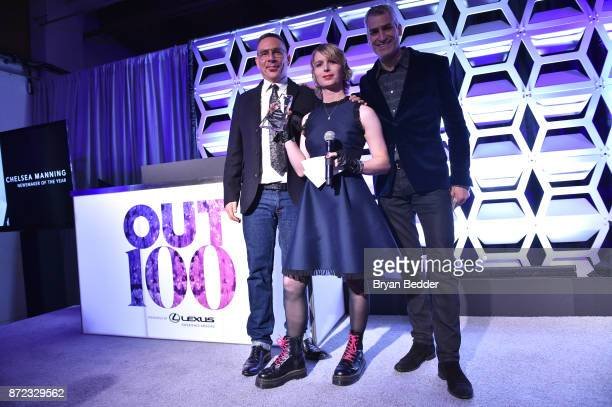 Magazine EditorinChief Aaron Hicklin OUT100 Newsmaker of the Year Chelsea Manning and OUT Magazine Executive VP Publishing Joe Landry pose for a...