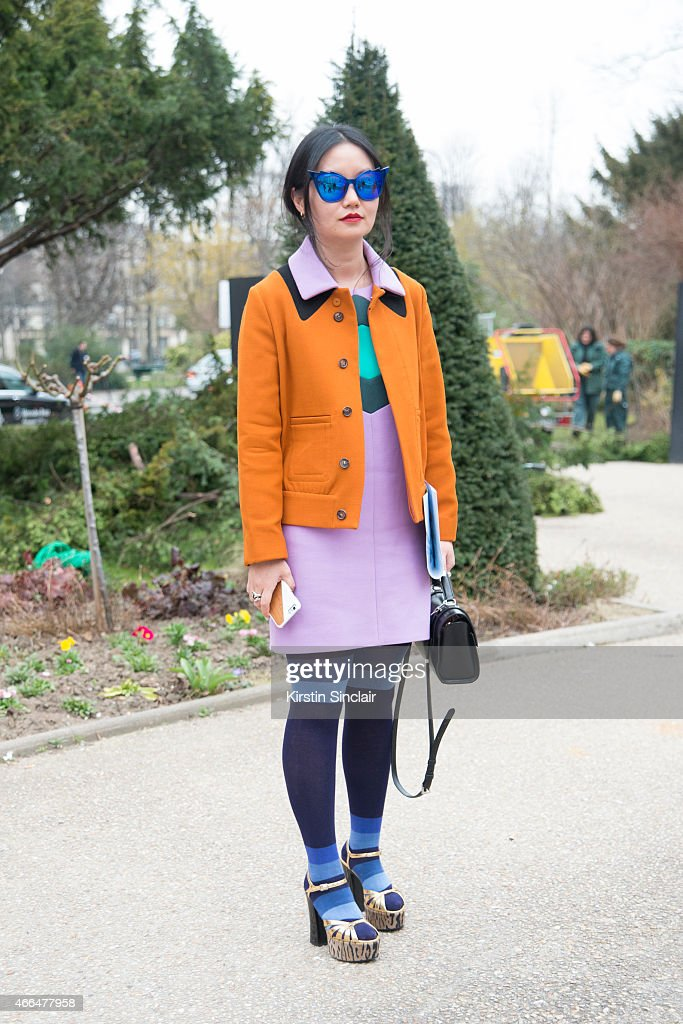 T magazine fashion stylist Lucia Liu wears Dita sunglasses Marni jacket and dress and Saint Laurent shoes on day 7 of Paris Collections Women on...