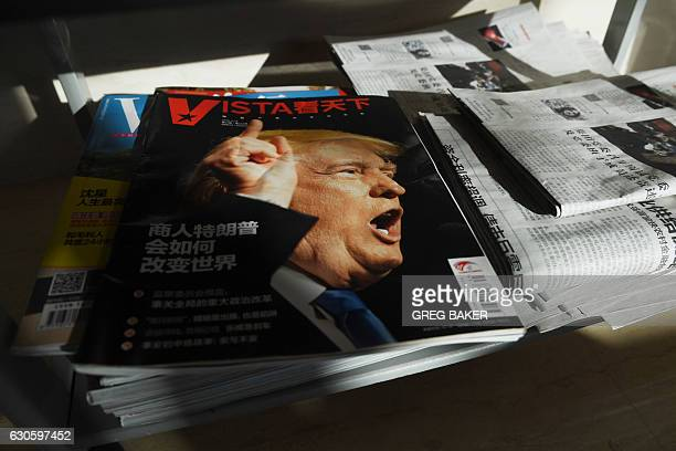 A magazine featuring a front page story on US Presidentelect Donald Trump sits on a magazine rack at a company office in Beijing on December 28 2016...