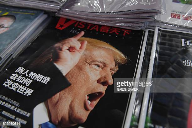 A magazine featuring US Presidentelect Donald Trump is seen at a bookstore in Beijing on December 12 2016 The headline reads 'How will businessman...