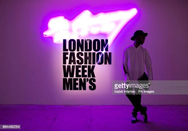 Magazine Gents editor Paris Warren from New York poses for pictures by the main logo at the BFC Show Space London during the London Fashion Week...