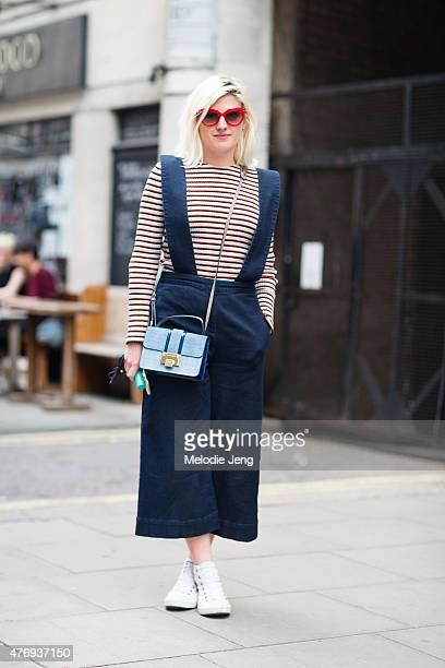 Magazine junior fashion editor Jenny Kennedy wears Tibi dungarees a Jimmy Choo bag Agent Provocateur for Linda Farrow sunglasses and Converse shoes...