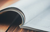 A magazine in shallow focus with copy space