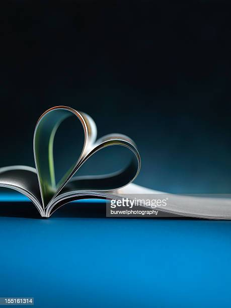Magazine or book, Heart Shaped on dark blue