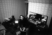LIFE magazine photographer I C Rapoport finds a few moments to rest in the only room available after the horrible disaster of October 21st in Aberfan...