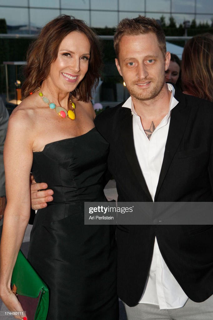 LA Magazine Publisher Alison Miller and Chef Michael Voltaggio arrives at Los Angeles Confidential Magazine Celebrates With Cover Star Sean Combs Summer Issue Party Honors LA's Business Titans at JW Marriott Los Angeles at L.A. LIVE on July 25, 2013 in Los Angeles, California.