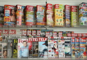 Magazines and newspapers of German publisher Axel Springer stand on display at the comapny's annual press conference during which CEO Mathias...