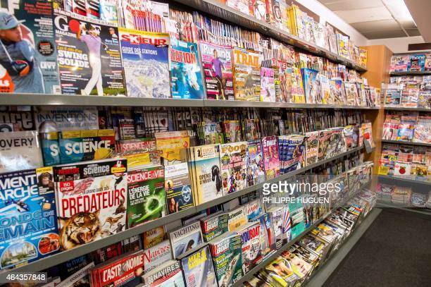 Magazines are on display at a newsstand on February 25 2015 in Lille AFP PHOTO /PHILIPPE HUGUEN