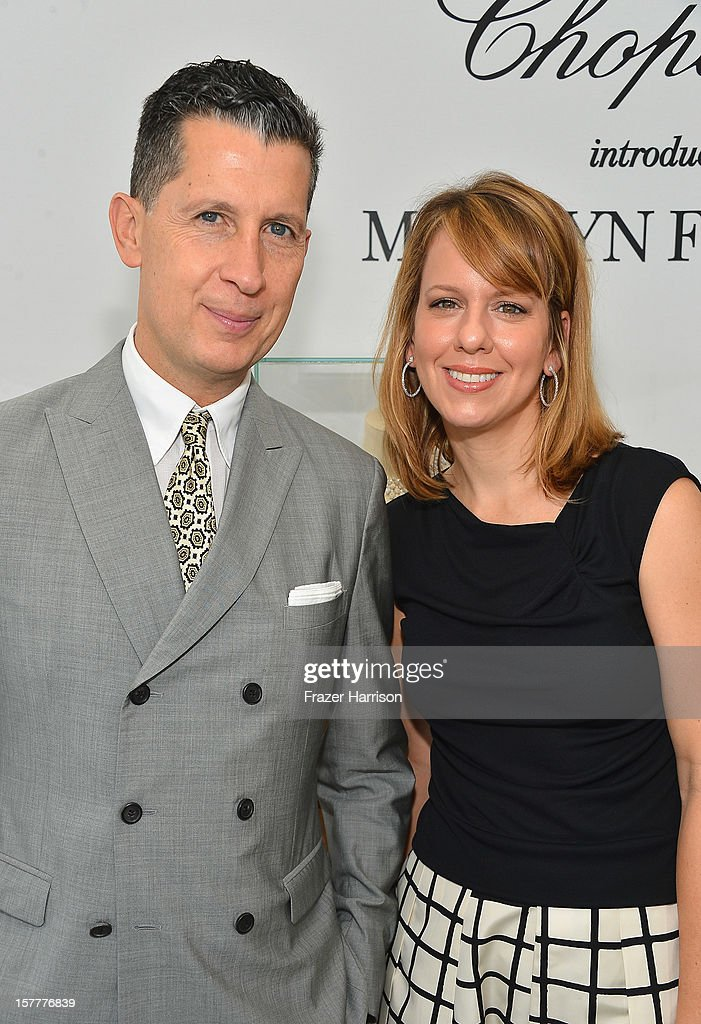 W magazine's Editor-in-Chief Stefano Tonchi and Vice President and Publisher Lucy Kriz attend the Chopard and W Magazine 'Marilyn Forever' exhibition at Soho Beach House on December 6, 2012 during Art Basel Miami in Miami Beach, Florida.