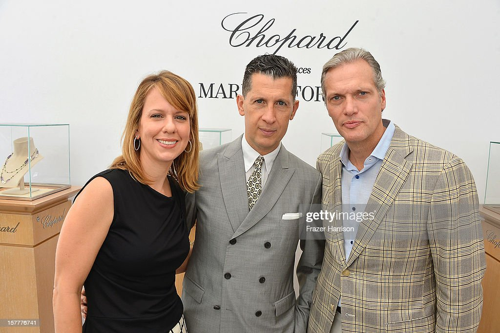W magazine's Vice President and Publisher Lucy Kriz and Editor-in-Chief <a gi-track='captionPersonalityLinkClicked' href=/galleries/search?phrase=Stefano+Tonchi&family=editorial&specificpeople=2497117 ng-click='$event.stopPropagation()'>Stefano Tonchi</a>, and President and CEO at Chopard U.S. Marc Hruschka attend the Chopard and W Magazine 'Marilyn Forever' exhibition at Soho Beach House on December 6, 2012 during Art Basel Miami in Miami Beach, Florida.