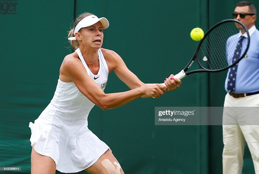 Magda Linette of Poland in action against Samantha Stosur of Austria in the womens' singles on day one of the 2016 Wimbledon Championships at the All England Lawn Tennis and Croquet Club in London, United Kingdom on June 27, 2016.