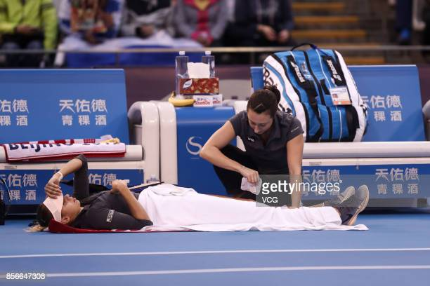Magda Linette of Poland lies on the ground during the Women's singles second round match against Elena Vesnina of Russia on day three of the 2017...