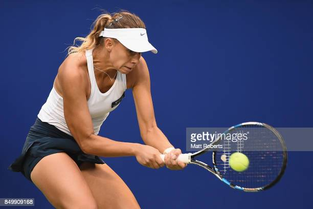 Magda Linette of Poland plays a backhand against Karolina Pliskova of Czech Republic during day three of the Toray Pan Pacific Open Tennis At Ariake...