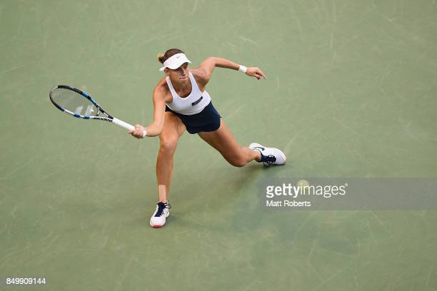 Magda Linette of Poland plays a forehand against Karolina Pliskova of Czech Republic during day three of the Toray Pan Pacific Open Tennis At Ariake...