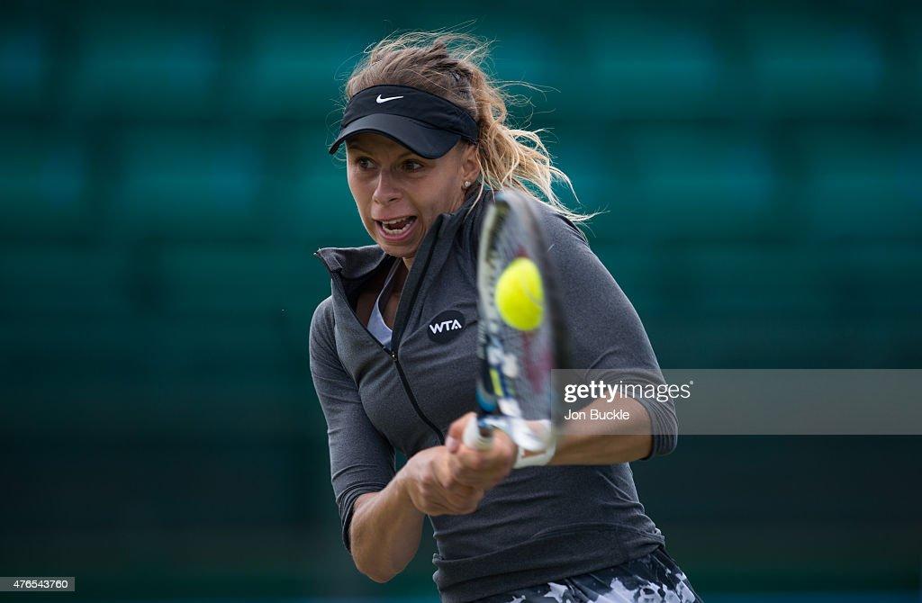 Magda Linette of Poland returns a shot during her match against Lauren Davis on day three of the WTA Aegon Open Nottingham at Nottingham Tennis Centre on June 10, 2015 in Nottingham, England.