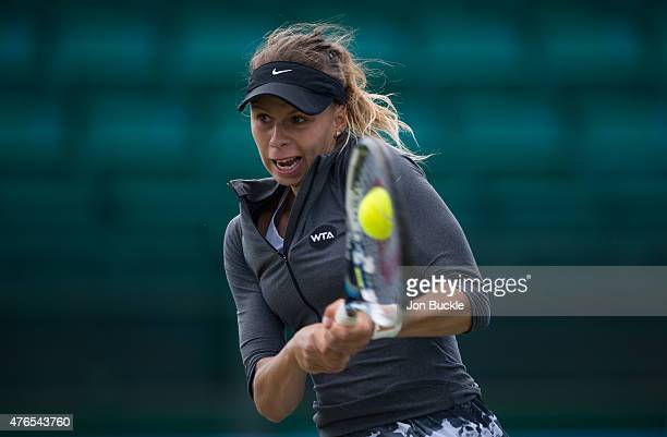 Magda Linette of Poland returns a shot during her match against Lauren Davis on day three of the WTA Aegon Open Nottingham at Nottingham Tennis...