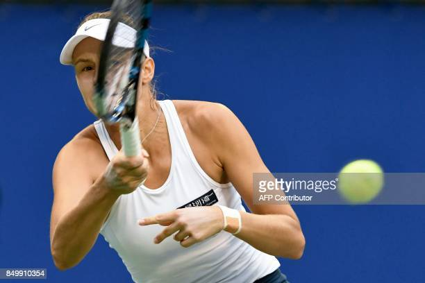 Magda Linette of Poland returns a shot to Karolina Pliskova of Czech Republic during their women's singles second round match at the Pan Pacific Open...