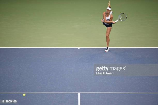 Magda Linette of Poland serves against Karolina Pliskova of Czech Republic during day three of the Toray Pan Pacific Open Tennis At Ariake Coliseum...