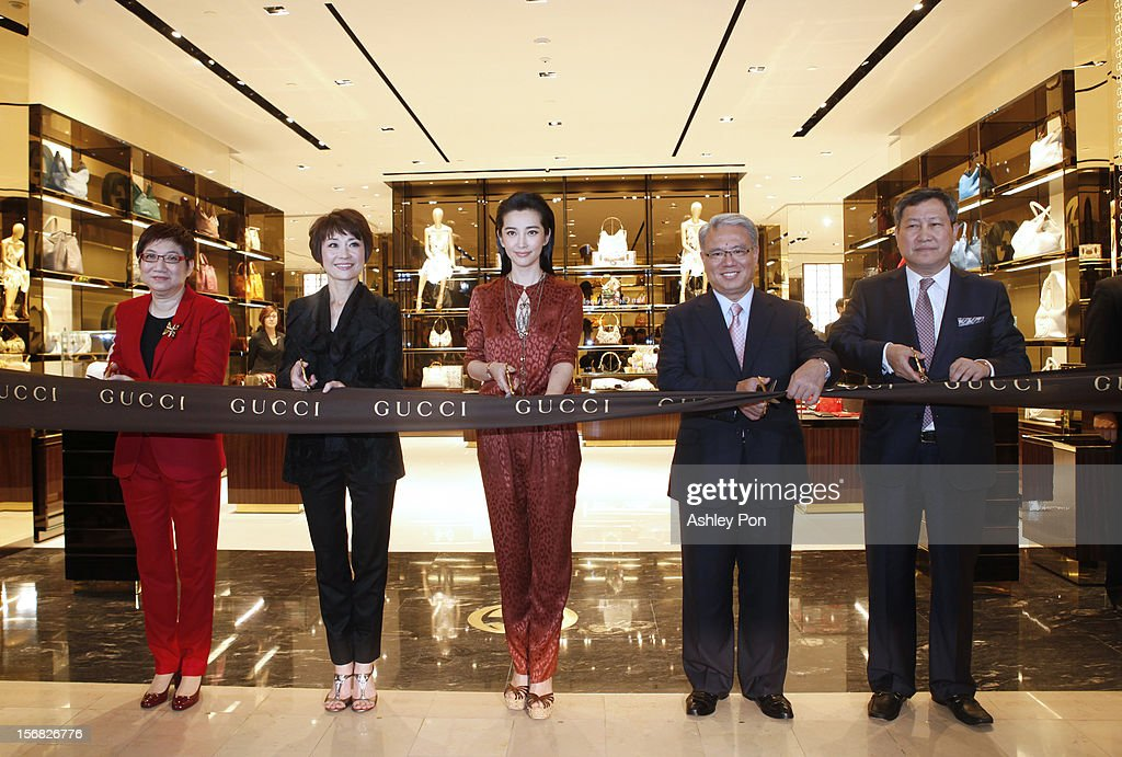 Magdalen Ho, Carol Shen, Li Bingbing and Wei Ying-chiao and Zhao Guo-shuai attend the ribbon cutting at the Gucci Flagship store opening at Taipei101 on November 22, 2012 in Taipei, Taiwan.