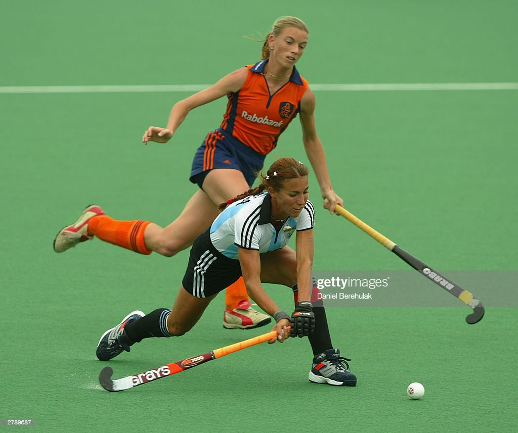 Magdalena Aciega of Argentina prepares to hit as Mintje Donners of Netherlands approaches during the BDO Hockey Champions Trophy 3rd place playoff...