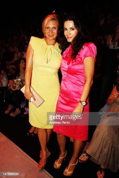 Magdalena Brzeska and Mariella Ahrens sit in the front row of the Unrath Strano show at the MercedesBenz Fashion Week Spring/Summer 2013 on July 5...